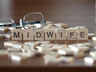 midwife the word or concept represented by wooden letter tiles
