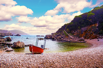 Foto auf Acrylglas Südeuropa Charming landscape with a red boat near the shore on Limni Beach Glyko on the coast of the Ionian Sea in Corfu, Greece. Amazing places. Tourist Attractions.