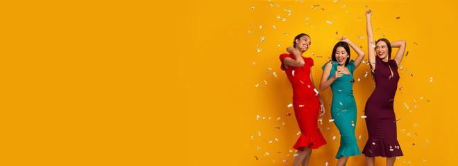 Three Happy Girls In Dresses Having Fun With Confetti, Studio