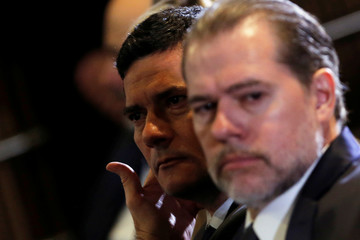 Brazil's Justice Minister Sergio Moro gestures near the President of Brazil's Supreme Federal Court Dias Toffoi during a seminary in Brasilia