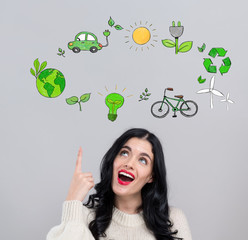 Eco theme with happy young woman on a gray background