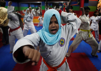 A girl reacts during a training session at a self-defence class in Mumbai,