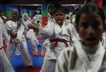 Girls react during a training session at a self-defence class in Mumbai