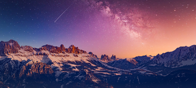 Snowy rocky mountain with a beautiful starry night, space fort text