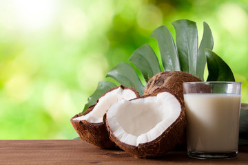 Foto auf AluDibond Palms natural coconut open with coconut milk and tropical leaf