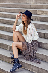 Fashionable woman in stylish clothes