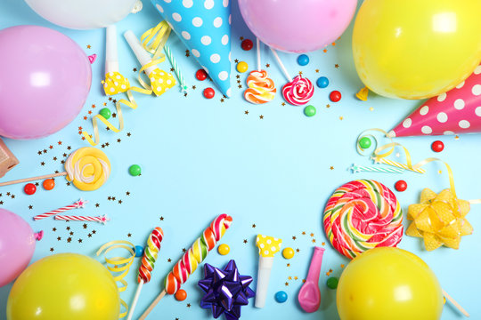 Flatlay composition with accessories for a party or birthday on a colored background with place for text top view.