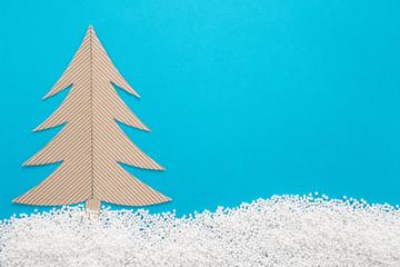 Spruce made of corrugated cardboard on blue background
