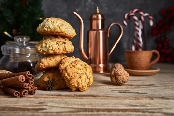 Christmas treat with cookies hot coffee and candies. Festive card new year decoration on wooden board in rustic style.