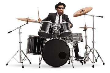 Papiers peints Magasin de musique Man in a suit playing drums