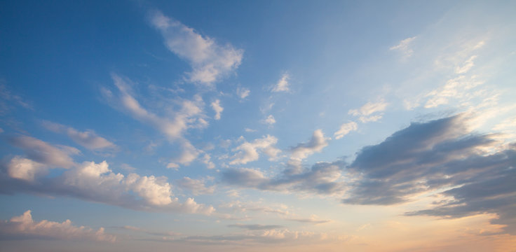 Blue sky clouds background. Beautiful landscape with clouds and orange sun on sky