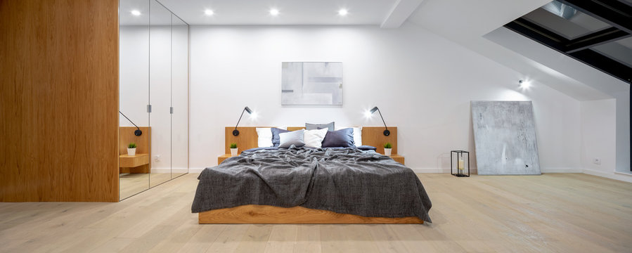 Attic bedroom with wooden bed