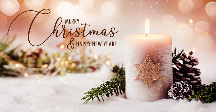 Romantic winter and christmas greeting card with text - Burning candle with natural fir and pine cone decoration on a bright background