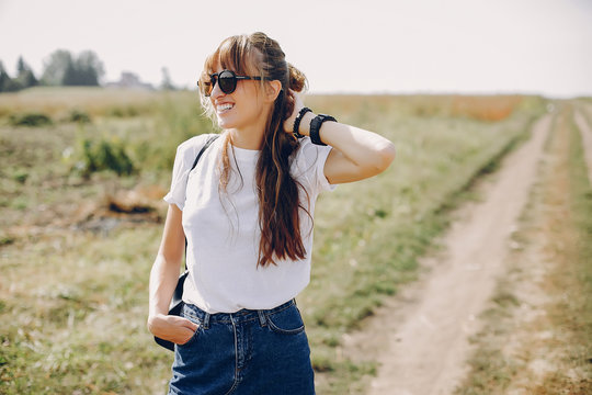 Beautiful girl in a park. Stylish girl in a white t-shirt
