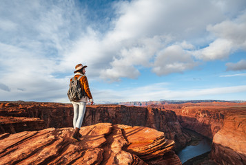 Young hiker with a backpack by the Glen Canyon Wall mural