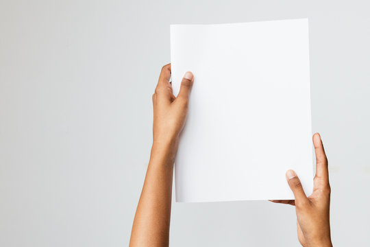 Woman of color holding a letter size or A4 brochure mockup