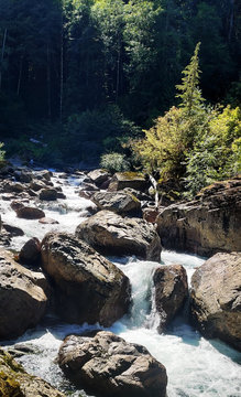 Shimmering cascades and bountiful boulders on the North Fork Sauk River in the Summertime off the Mountain Loop Highway in Silverton Washington State Snohomish County