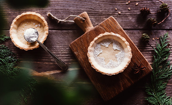Traditional homemade Christmas pie on dark wooden background / Merry Christmas