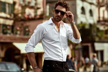 Stylish man wearing sunglasses and white shirt
