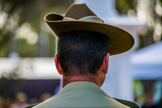 Close-up contemplative Australian Army soldier wearing Slouch Hat during ANZAC Day remembrance service in Cooroy