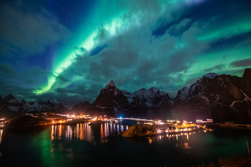 Photo sur Toile Aurore polaire Aurora borealis on the Lofoten islands, Norway. Green northern lights above mountains. Night sky with polar lights. Night winter landscape