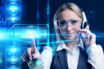Business, Technology, Internet and network concept. Marketing content. Businessman presses a button Video marketing on the virtual screen tablet future.