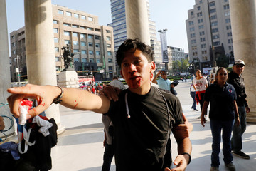 A man reacts after a group of people, who are part of a farm union, blocked the entrance of the Fine Arts Palace and got on a fight with LGBT members about a painting showing an exhibition of Mexican revolutionary hero Emiliano Zapata nude while wearing hi