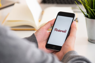 CHIANG MAI, THAILAND - MAR 13, 2018: Apple iPhone with Pinterest application on the screen. Pinterest is an online pinboard that allows people to pin their interesting things.