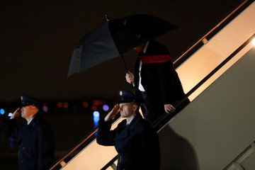 U.S. President Donald Trump descends from Air Force One at Andrews Air Force Base in Maryland