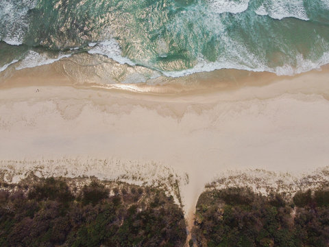 Aerial view of beautiful sea waves and sandy beach, summer holidays travel tourism, relaxing and wellness concept, drone above view, world oceans day