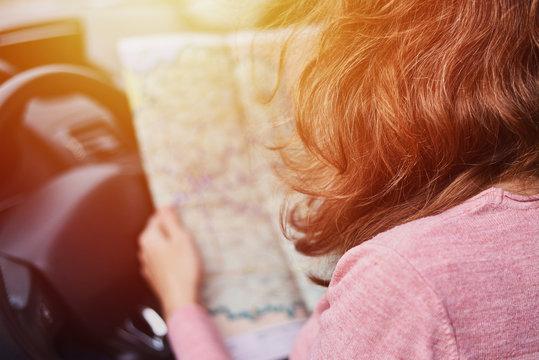 Woman looking at the navigation map while driving car