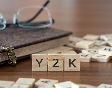 y2k the word or concept represented by wooden letter tiles