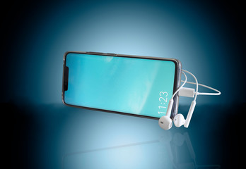Smartphone and headphones on a blue background.