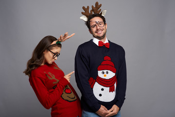 Funny couple posing in Christmas clothes