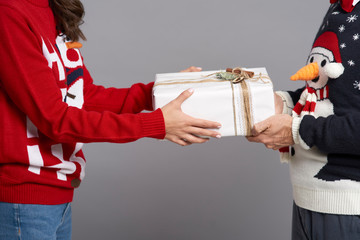 Close up of couple holding Christmas gift