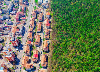 aerial view of half forest and city of Piatra Neamt, Romania.