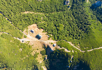 house in the forest. aerial view in mountains of Romania