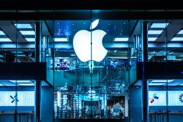 The Apple Logo on Apple Store facade in Hongkong at night - November, 2019