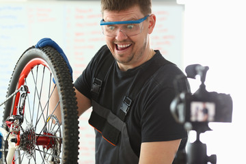 Handsome blogger service man bicycle