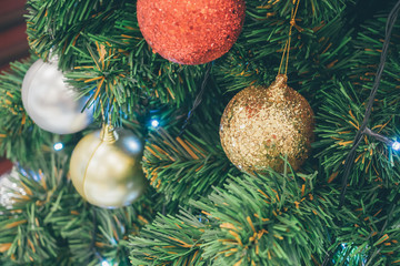 Decorated Christmas ball on fir tree New Year holidays background