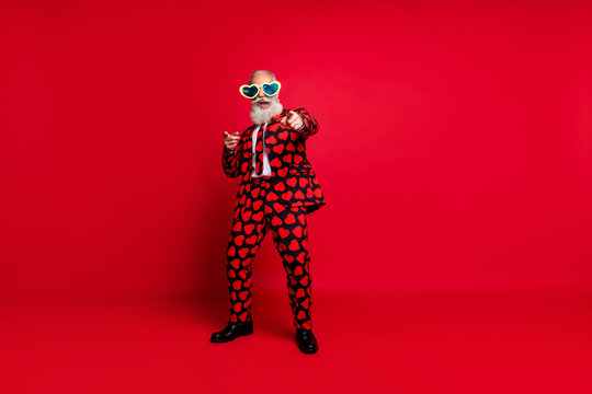 Full length body size view of his he nice attractive cool crazy cheerful cheery glad white-haired guy dancing having fun take pick you isolated on bright vivid shine vibrant red color background