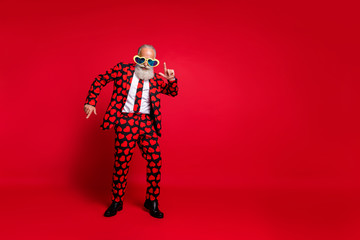 Full length photo of funky aged man amour cupid character role play dancing corporate party wear sun specs hearts pattern suit costume isolated vibrant color background