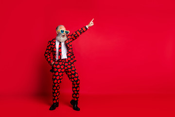 Full length body size view of his he nice attractive trendy crazy cool cheerful cheery white-haired guy dancing having fun clubbing isolated on bright vivid shine vibrant red color background