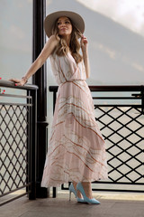 Fashionable woman in summer dress relaxing outdoor