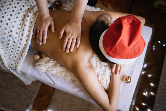 Female hands massaging young woman in SPA