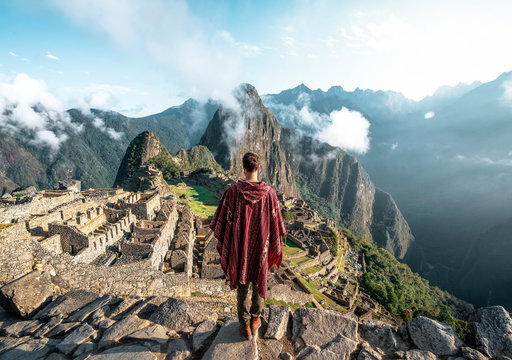 Man observing the ruins of Machu Picchu
