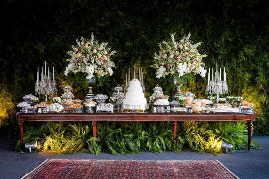 An elegant and impressive cake and candy  table for a wedding
