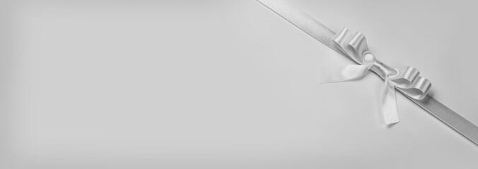 Wall Mural - White ribbon bow on gray