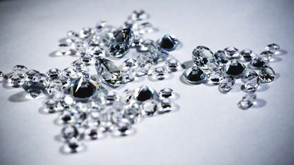 Shiny diamonds stones laying on white table