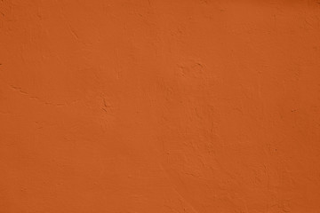 Saturated orange colored low contrast Concrete textured background with roughness and...